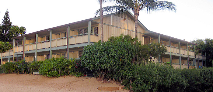 Unit 112 is the fourth ground floor unit on the right side of this picture.  It is only 40 feet from the lanai to the sand.
